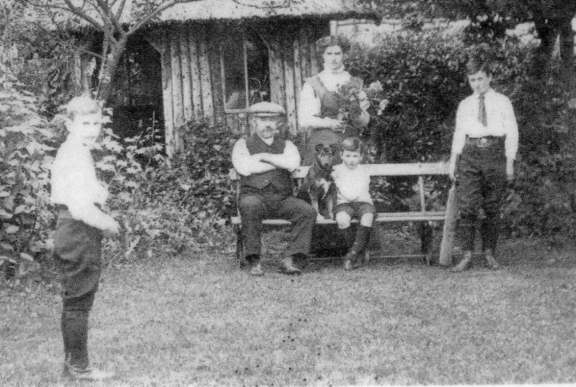 George Bentley and family in the back garden of Magnolia Cottage