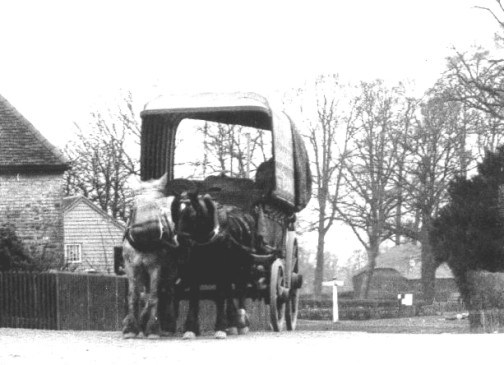 Possible a Carrier's Cart passing the Swan - from the Collier Collection