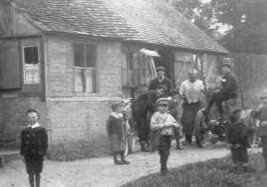 Children at the Forge - in their dinner hour, or in their Sunday best?