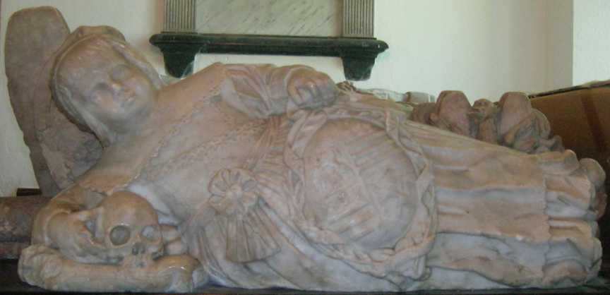 The child at the foot of William and Mary Standen - the skull's eye sockets fascinate small children