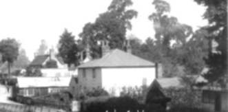 Whitewell Cottage, with Well in the front, workshops to left and Peacock Cottage to right