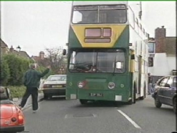 Roger Higgs directs a double-decker bus being driven as part of the 'Road-Block'