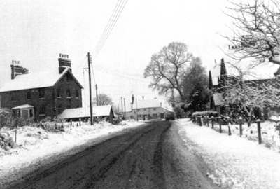 School Road, with Lanka House on left and New Cottages on right