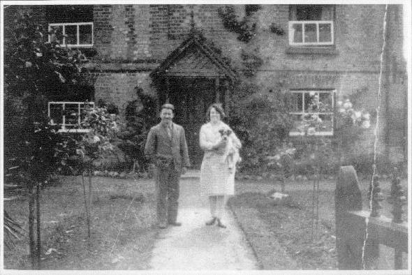 George Bentley and his wife in front of Magnolia Cottage
