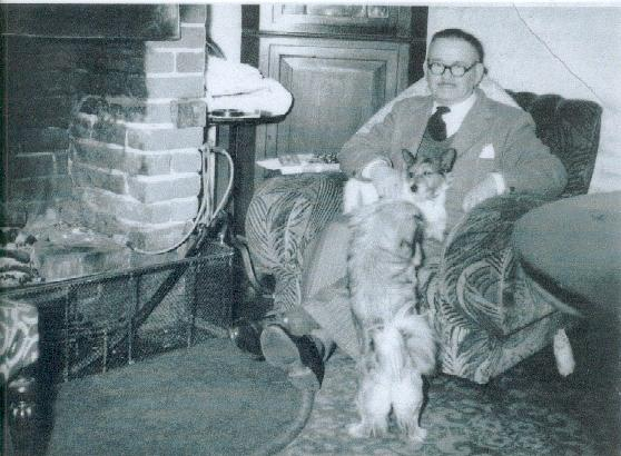 George Bentley beside his fireplace at Magnolia Cottage.