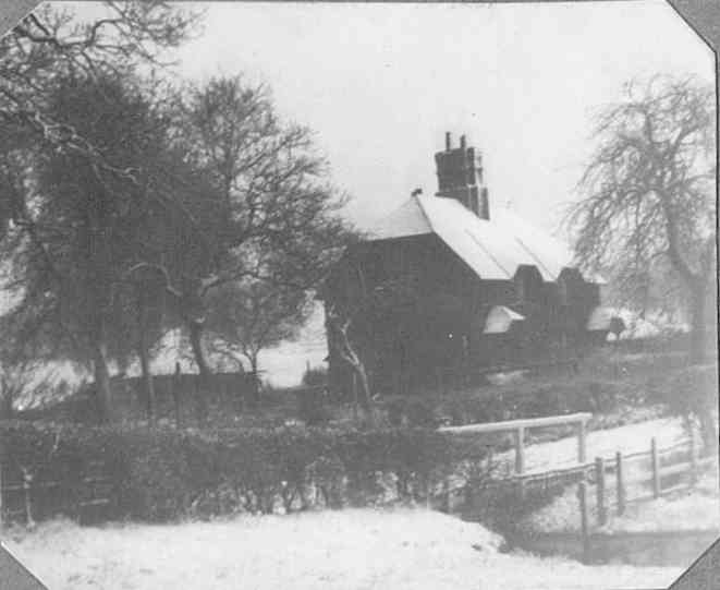 Brook Cottages in the snow, with the ford in the foreground