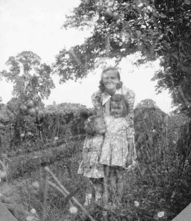 Joyce Slade and her daughters in the garden