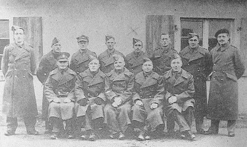 Alec W. Verrall, of Arborfield (fourth from right, back row), who has been a prisoner of war in Germany since June 1940