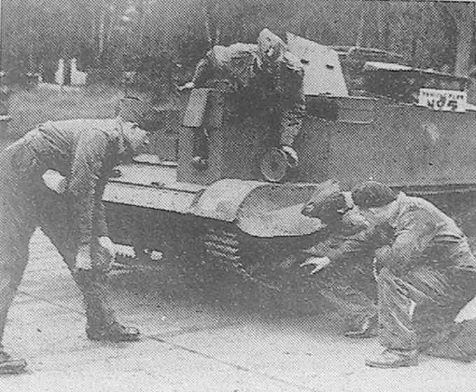 An Army Cadet force being shown repairs to a Bren carrier