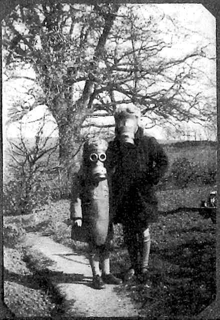 Carol and Pam wearning their gas-masks at Brook Cottage