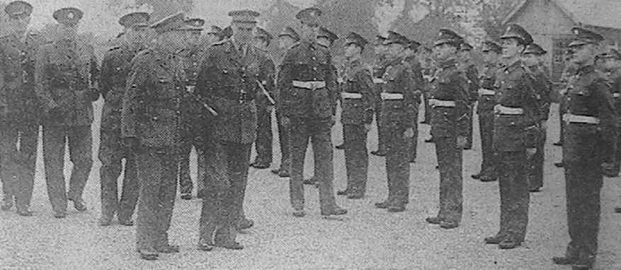 'Lt.-General Sir John Crocker, General Officer Commander-in-Chief, Southern Command, inspecting boys of the Army Technical School at Arborfield'