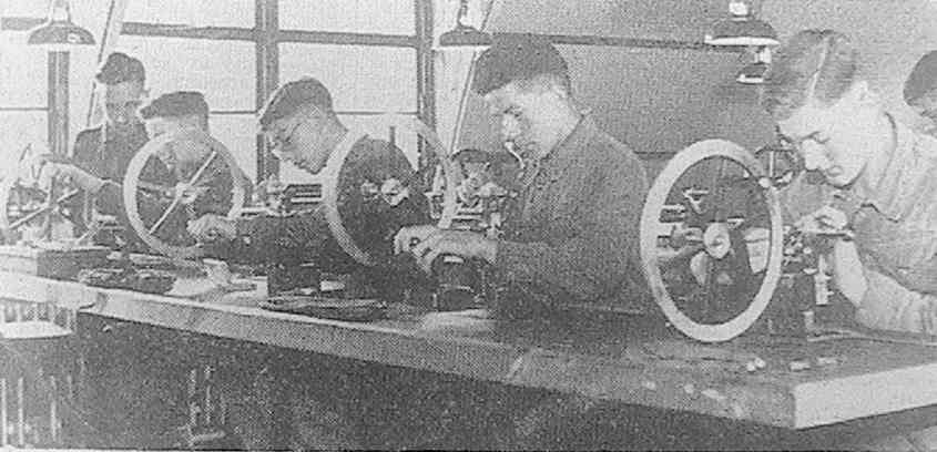 'Boys of the Army Technical School, Berkshire, being trained in watch-makers' lathe work. They are taught to turn out precision instruments'