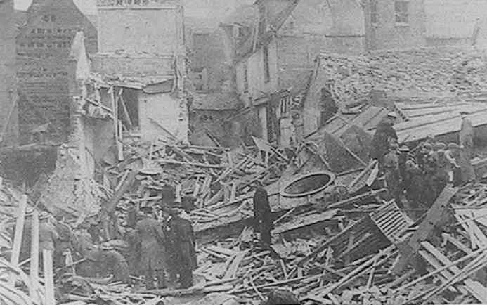 'A.R.P. Personnel and soldiers searching for victims amongst the ruins of a British Restaurant, destroyed in a raid on a Home Counties Town'