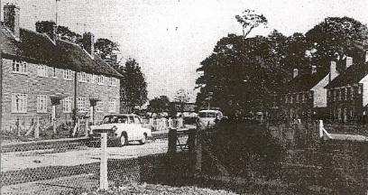Photo of existing road, fencing and gardens
