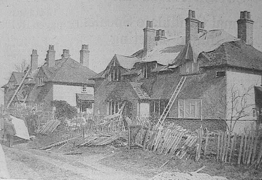 'Shortly after a V-Bomb dropped in a rural area of Southern England, workmen were busy repairing these cottages damaged by blast'